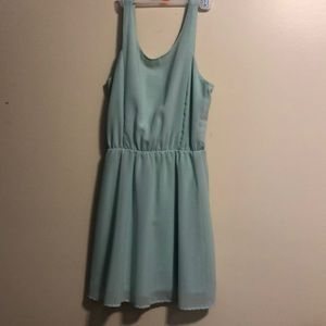 Light turquoise dress with open back